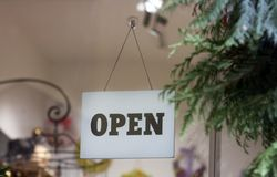 Open sign hanging on the glass door royalty free stock image