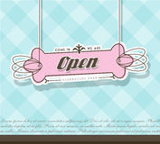 Open sign hanging on pink badge Stock Photos