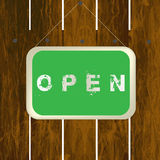 Open sign hanging on a wooden fence Royalty Free Stock Image