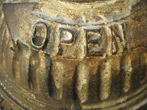 Open sign on hydrant Royalty Free Stock Image