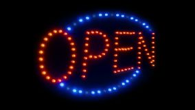 Open sign with lights running around