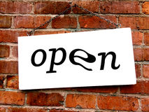 Open sign on old brick wall Stock Photography