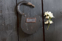 Open sign and old padlock Stock Photos