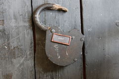 Open sign and old padlock Stock Photography