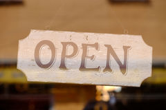 Open sign of a store behind a window Royalty Free Stock Photography