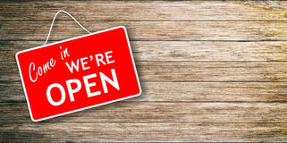 We are open sign on wooden background stock photography