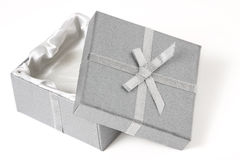 Open silver box with leaning top. Half open silver box with top leaning against the bottom; white background royalty free stock photo