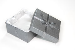 Open silver gift box with ribbon and bow. Whit background royalty free stock images