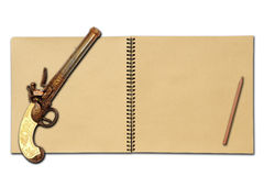 An open sketchbook with old flintlock gun Royalty Free Stock Image