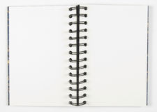 Open sketchbook with spiral center. Open blank book on white background. Plenty of copy space Royalty Free Stock Photography
