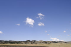 Open Sky in Colorado. Deep blue sky and white clouds on the plains between Colorado and Wyoming. Suitable for backgrounds. High resolution Stock Photo