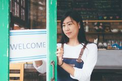 Young startup owner small cafe shop. Open Small business: Happy owner of a cafe. Young startup owner small cafe shop stock images