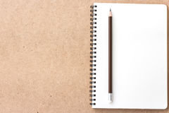 Open Small notepad with pencil and on wood Royalty Free Stock Images