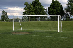 Open Soccer Goal. A view of a net on a vacant soccer pitch Stock Photos