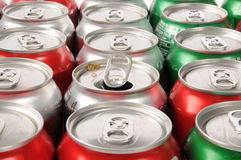 Open soft drink can. A single opened soft drink can in rows of drinks royalty free stock images