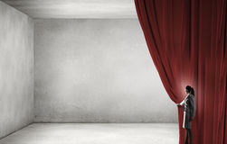 Open something new. Businesswoman opening curtain to new ways and opportunities Stock Image