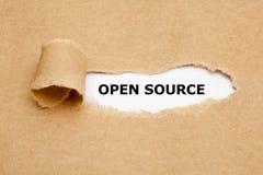 Open Source atrás do papel rasgado fotos de stock royalty free