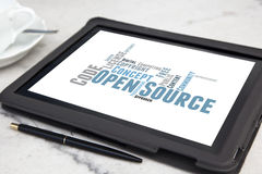 Open source software. Tablet with open source software word cloud Royalty Free Stock Photos