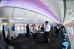 Open space in Boeing 787 Dreamliner cabin at Singapore Airshow 2012. SINGAPORE - FEBRUARY 12: Open space in Boeing 787 Dreamliner cabin at Singapore Airshow Stock Images