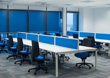 Open space. Many chairs and desks in office open space Royalty Free Stock Photo