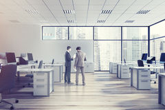 Open space office environment, men Stock Image