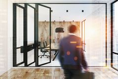 Open space office, white and wooden walls, man Stock Photo