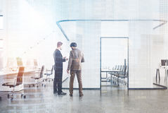 Open space office and meeting room, men. White open space office interior with a glass and white wood conference room in the center and a second floor. 3d Royalty Free Stock Image