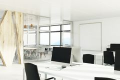 Open space office with a wooden wall, corner Stock Photo