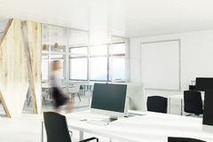 Open space office with a wooden wall, corner, girl Royalty Free Stock Photo