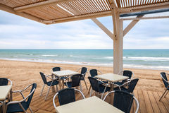 Open space seaside bar interior with wooden floor Royalty Free Stock Photography