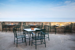 Open space seaside open restaurant interior. Open space seaside restaurant interior with metal chairs under blue sky Royalty Free Stock Images