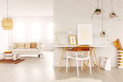 Free Open Space Study Corner With Desk With Two Posters And Lamp, Fresh Plants And Plastic Chair In Bright Living Room In Royalty Free Stock Photography - 128408947