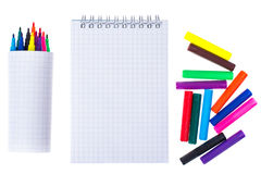 Open spiral blank notebook with color markers on white backgroun Royalty Free Stock Images