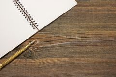 Open Spiral Bound Notebook With White Pages And Gold Pen. Royalty Free Stock Image