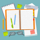 Open spiral notebook and office supplies. Stock Photography