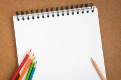 Open spiral sketchbook with colored pencils Royalty Free Stock Image