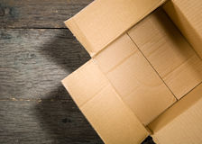 Open square cardboard box on the background of the old wooden table. Stock Photography