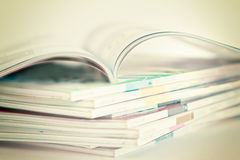 Open and Stacking of magazines. Selective soft focus of open and Stacking of magazines Stock Photo