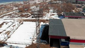 Outdoor stadium in spring. Open stadium in the spring, a tower with spotlights, aerial shooting from the copter stock video