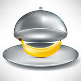 Open stainless catering tray with banana Royalty Free Stock Images