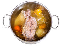 Open steel pan with cooking beef broth Stock Image