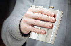 Open steel small flask in male hand Royalty Free Stock Image