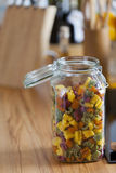 Open Storage Jar with colorful Pasta on Worktop Royalty Free Stock Photo