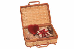Open straw chest with red heart Stock Images
