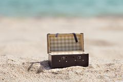 Open suitcase on beach Royalty Free Stock Images