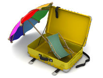 Open suitcase with beach umbrella and sun loungers Stock Photo