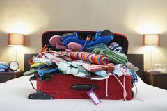 Open suitcase on bed Royalty Free Stock Photography