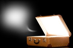 Open suitcase on black background Stock Image