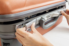 Open suitcase with clothes on bed Royalty Free Stock Photo