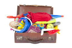 Open suitcase full of summer vacation Stock Images